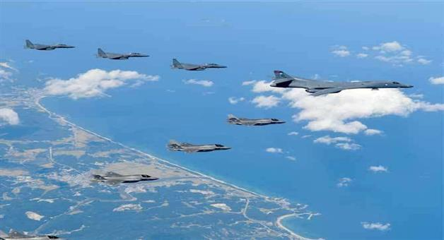 Khabar Odisha:Us-flew-four-stealth-fighter-jets-and-two-bombers-over-the-Korean-peninsula