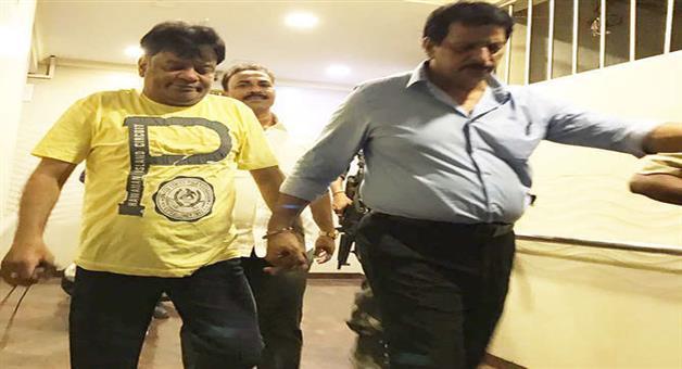 Khabar Odisha:iqbal-kaskar-eating-biryani-and-watching-a-reality-tv-show-during-thane-police-raid
