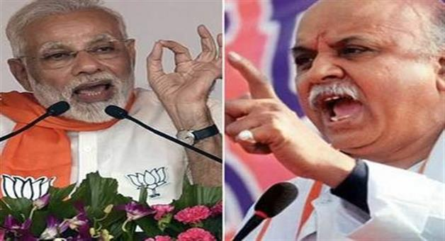 Khabar Odisha:rss-to-axe-togadia-for-attacks-on-modi-govt