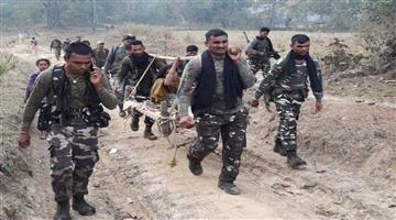Khabar Odisha:Nation-CRPF-team-carry-pregnant-woman-on-cot-for-6-km-through-jungles-to-reach-hospital