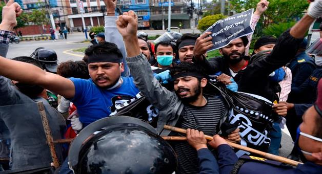 Khabar Odisha:Protests-were-held-in-Kathmandu-on-Wednesday-against-Chinese-occupation-of-Nepali-land-and-building