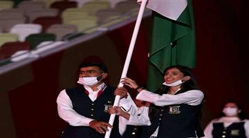 Khabar Odisha:Sports-Pakistan-team-flag-bearer-flouts-covid-rules-marches-mask-free-at-Tokyo-Olympics