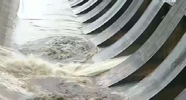 Khabar Odisha:State-Odisha-Hirakud-Dam-releases-seasons-first-floodwater-Currently-water-is-being-discharged-through-sluice-gate-number-7-of-the-dam