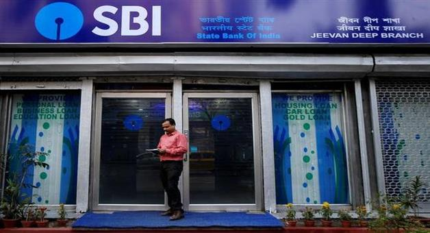 Khabar Odisha:sbi-recorded-quarterly-loss-for-third-time-npa-comes-down